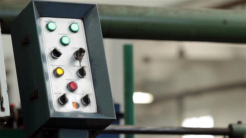 Control Console in a Mechanized Industry Live Action