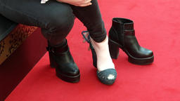 Dressing up a shoe on a woman's leg Footage