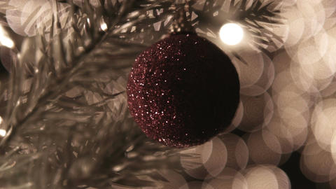 Christmas ball decoration on tree with bokeh lights Footage