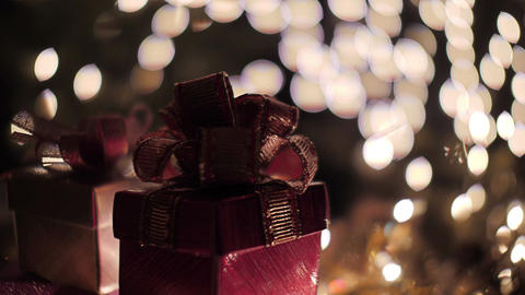 Red Christmas gift boxes with illuminated bokeh lights background Footage