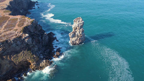 Aerial View Seascape with Waves on Rocky Island Live Action