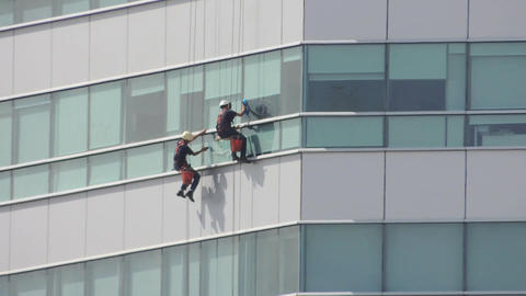 Climber cleaning modern building Archivo