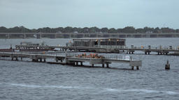 USA Virginia Norfolk landing stages for fishing boats in the bay ビデオ