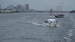 USA Virginia Norfolk coast guard boat in stern wave of cruise ship Image