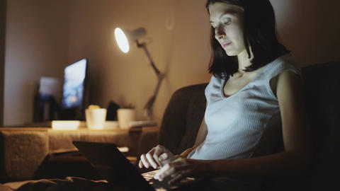 Young attractive woman sharing social media using on laptop computer at home in Footage