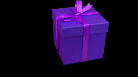 Blue gift box with purple ribbon bow rotate at transparent background. Alpha Footage