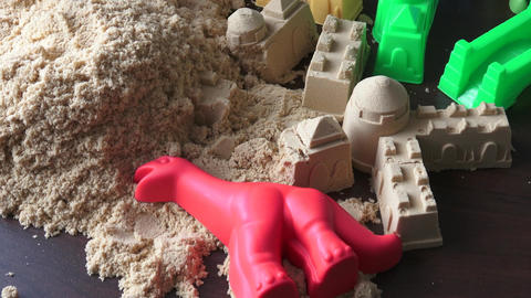 Kinetic sand heap for children. Kinetic sand close-up Live Action
