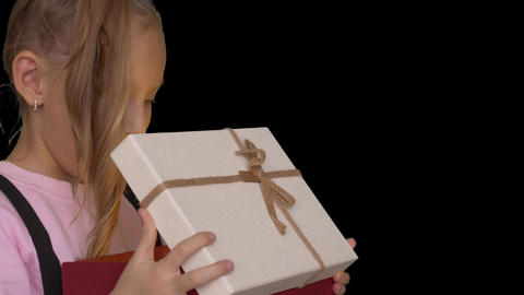 Young caucasian girl open gift box front view. Man hand give present to white Footage