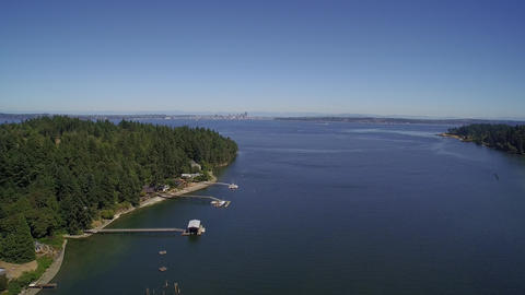 Aerial view. Flight over Eagle Harbor Marina, in foreground Seattle - Bainbridge Footage