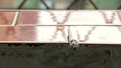 Lit cigarette on ledge 2 1 Live Action