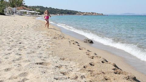 little girl running on beach Footage