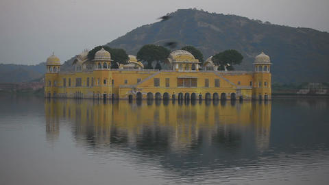 Jal mahal palace on lake at night in Jaipur India Footage