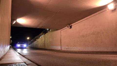 Cars passing through an underpass under the railway 9 Footage