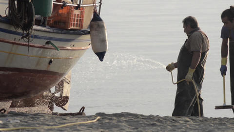 Fishermen who clean their boat of salt deposited after a fishing tour 0b Footage