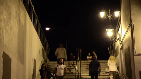 People who descended the stairs and then pass a pedestrian passage under the rai Footage