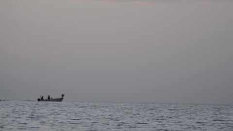Returning from offshore fishing boats after a fishing expedition at sunset 2 Footage