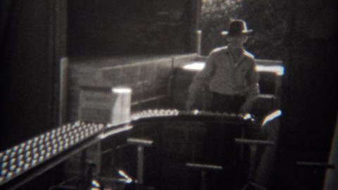 1946: Boxes moving conveyor belt at industrial packing facility Footage