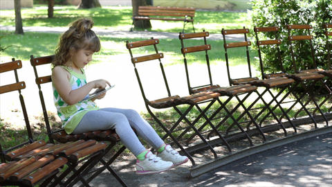 little girl fun with tablet pc Live Action