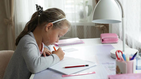 Little school girl doing homework Footage