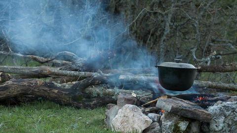 Tourist campfire. Preparing food Footage