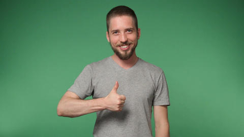 hipster man in a gray shirt showing thumb up Footage