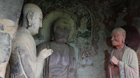 Art Statues Sculptures Paintings At Maijishan Grottoes In China Asia Footage