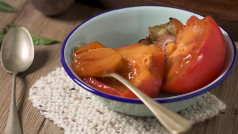 Persimmon fruit on rustic table Footage