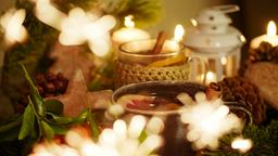 Christmas Decor with Tea, Candles, Mandarins, Gingerbread and Blured Sparkler フォト