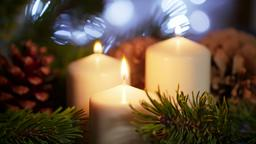 4K Nice Long CloseUp of Lighted Candles with Christmas Ornament in Slow Motion フォト