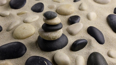 Stones pyramid on sand standing among the rocks, harmony Footage