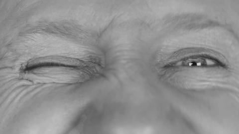 Close-up in black and white on man's eyes, winking eyes Footage