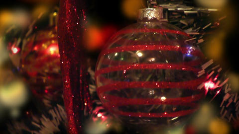 Detail of decorated Christmas tree at night, colorful lights, red transparent Animation