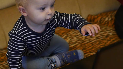 cute 9-10 months old baby boy pressing button on pc keyboard Footage