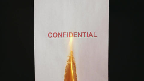 Confidential document. Burning a confidential paper document Image