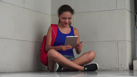 Female College Student Having Fun Using Tablet Live Action