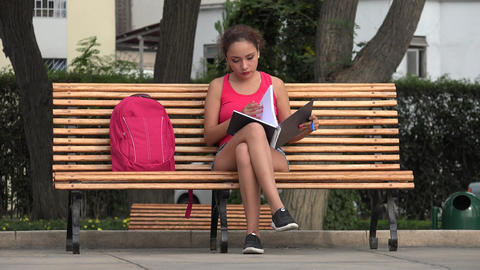 Female College Student Studying On Park Bench Live Action