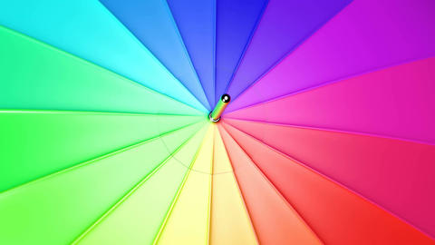 UHD closeup of the spinning colorful umbrella Stock Video Footage