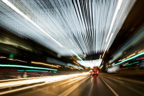 Driving Around Town. Light Rain. Long Exposure Photo