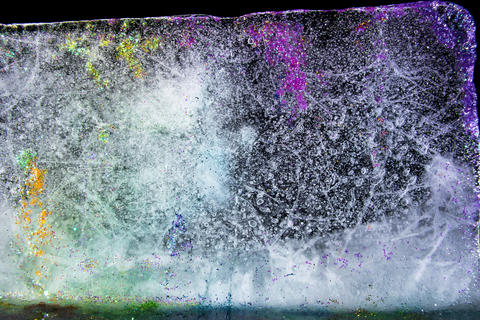 Colored ice with glitter, melting Photo