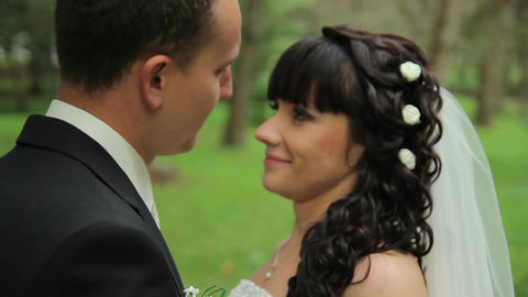 Portrait of newlywed couple in love in park. tenderness love Footage