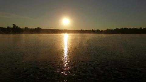 Beautiful sunset over lake - aerial shot Footage
