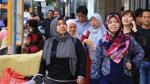 People walking crowded street in asian city Footage