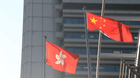 Flags of China and Hong Kong waving in the wind Archivo