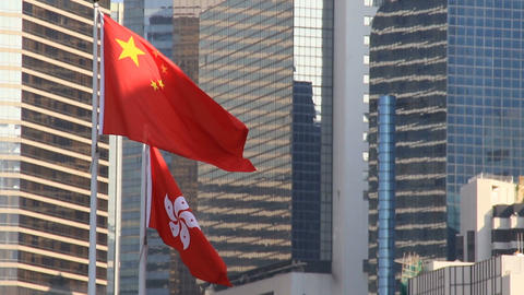 Flags of China and Hong Kong flying in the wind Archivo