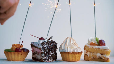 Different cupcakes with sparklers. Idea for holidays, birthdays, anniversaries, ビデオ