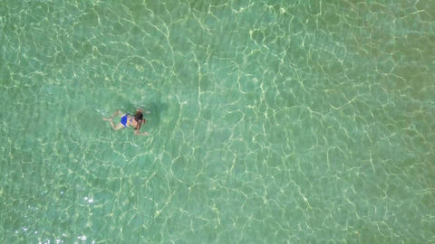 View from the height on swimming woman in the clear sea ビデオ