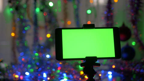 smartphone with a green screen on a new years background movement of the footage