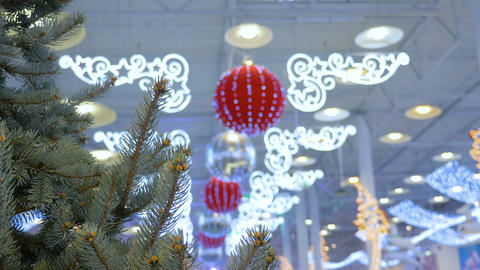 Christmas tree, is decorated in a shopping center. Holiday decorations, big Live Action