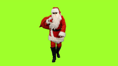 Santa in sunglasses carrying gifts in sack on green background, Chroma key Footage