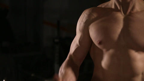 Handsome man with big muscles, posing in the gym muscular man lifting weights Live Action